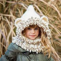 Stor tyk vinterhue i syntet-uld for børn